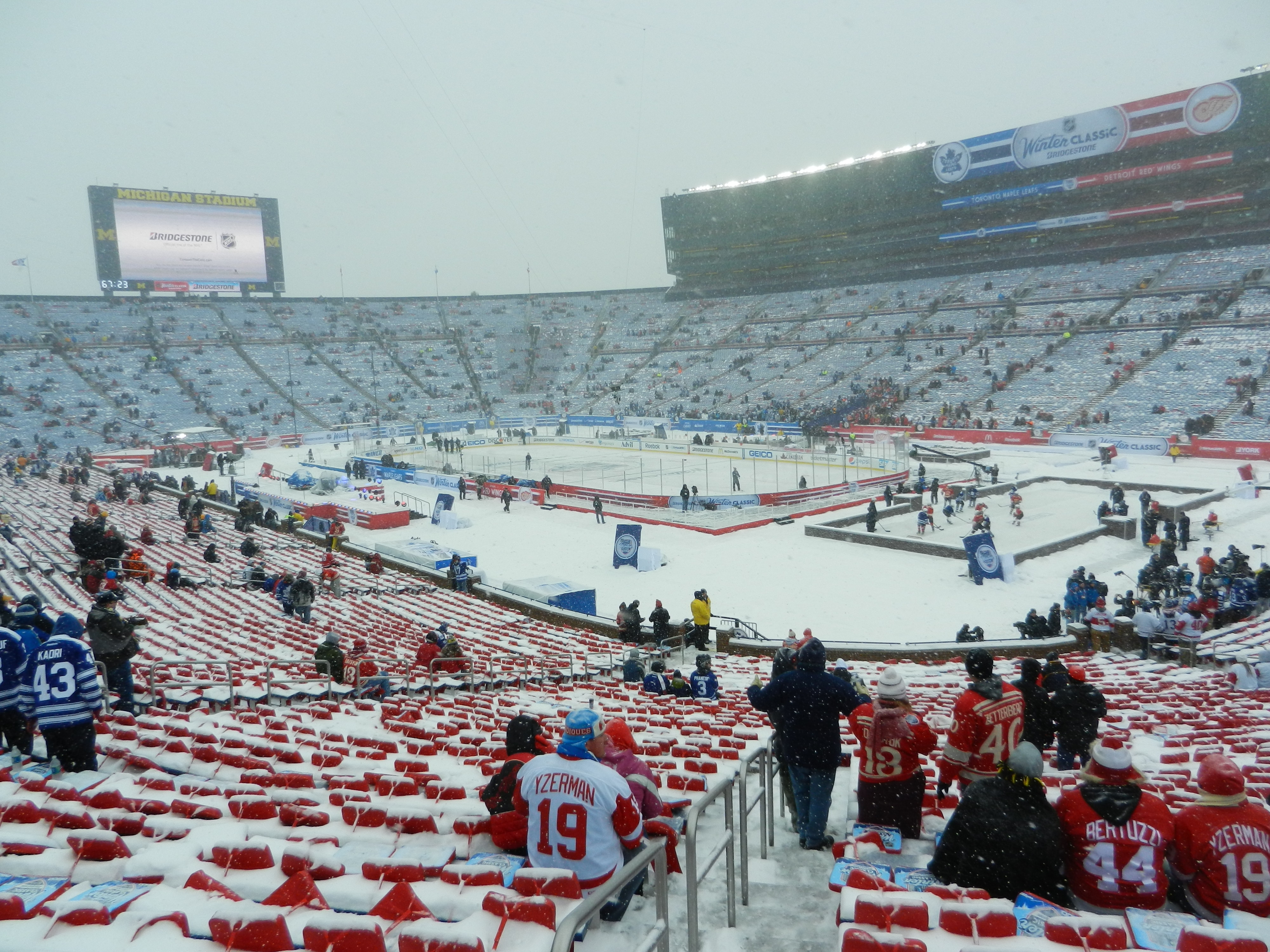 The snow keeps fallin as the crowd piles in. (CBSSports.com Original)