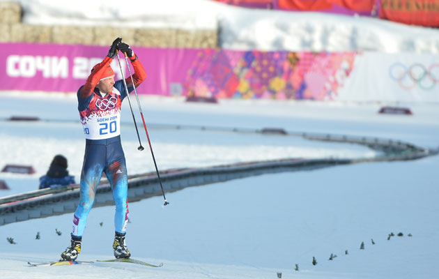 Gafarov acknowledges the crowd as he crosses the finish. (Getty Images)