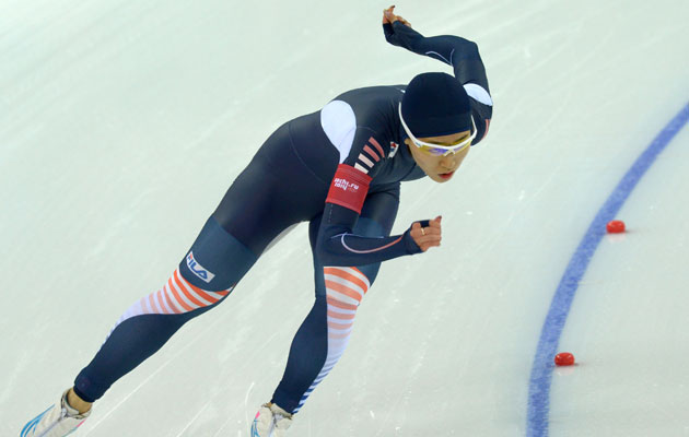 Lee blazes around the track to set a pair of records and win gold. (Getty Images)