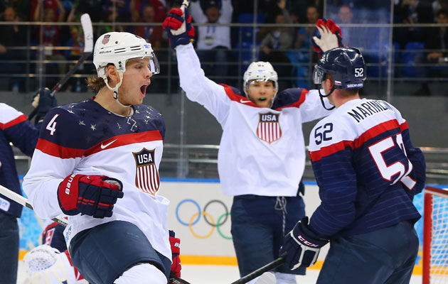 John Carlson celebrates his first-period goal. (Getty Images)