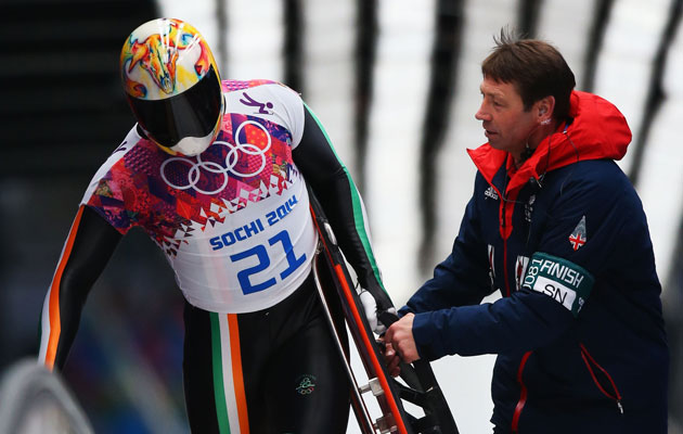 Sean Greenwood is assisted after his run. (Getty Images)