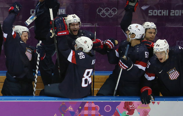 The US bench celebrates but Dustin Brown keeps his cool. (Getty Images)