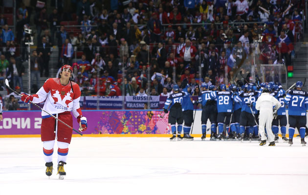 Alex Ovechkin skates off while Finland celebrates. (Getty Images)