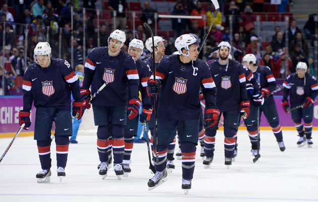 Team USA leaves the ice looking dejected after the loss to Finland. (Getty Images)