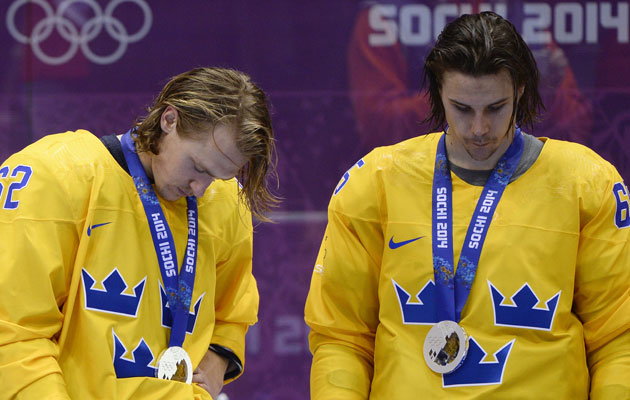 Carl Hagelin and Erik Karlsson receive their silver medals. (Getty Images)