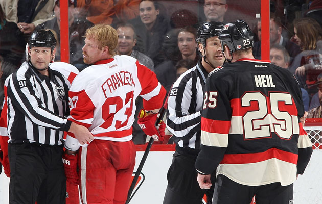 Johan Franzen and Chris Neil aren't seeing eye to eye. (Getty Images)