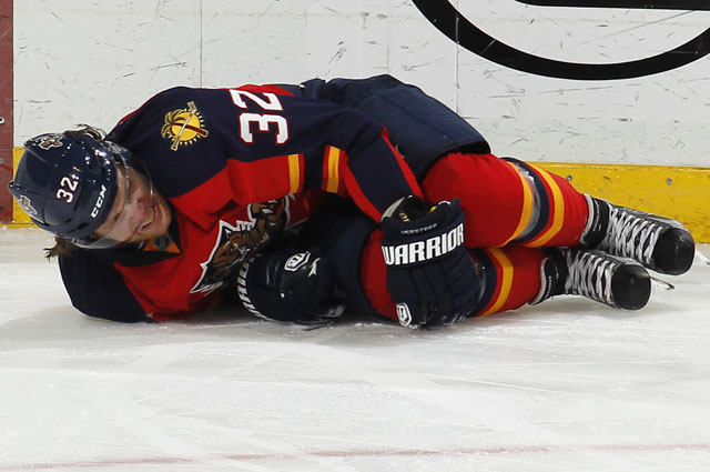Versteeg holds his knee after being hit on Tuesday night. (Getty Images)