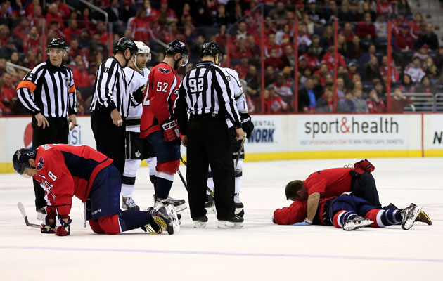 Alex Ovechkin and Jack Hillen stay down after their collision. (Getty Images)