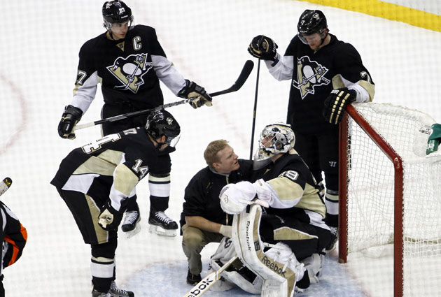 Pittsburgh Penguins goalie Marc-Andre Fleury had to leave Tuesday's game after the second period. (Getty Images)