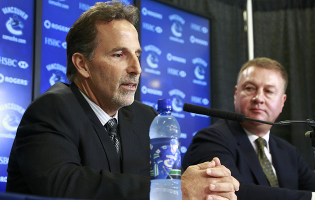 Mike Gillis (right) can't say if he or John Tortorella will return. (Getty Images)