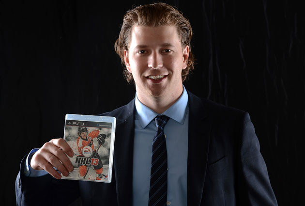 Giroux poses with last year's cover. (Getty Images)