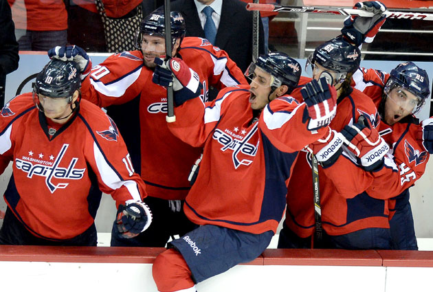 The Caps bench celebrates the final goal that sealed the division title. (Getty Images)