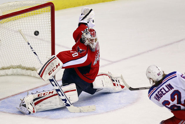 Holtby made a big stop on a Hagelin breakaway, one of 35 saves. (USATSI)