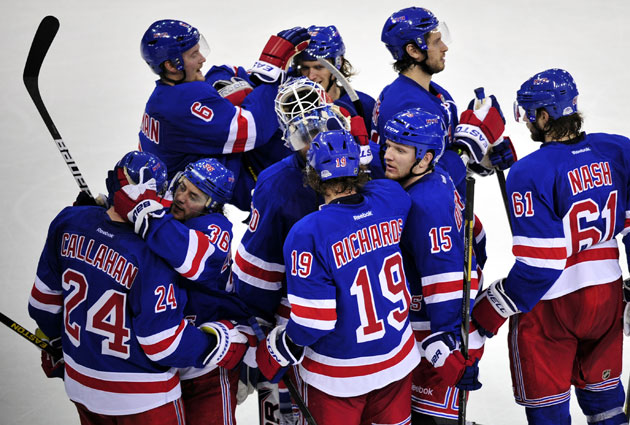 New York mobs Lundqvist after a spectacular shutout. (USATSI)
