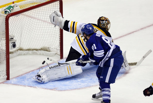 Kessel pots the game-winner past Rask. (USATSI)
