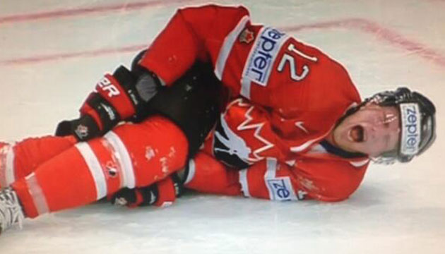 Staal on the ice in serious pain after taking a hit to the knee. (Screen grab)