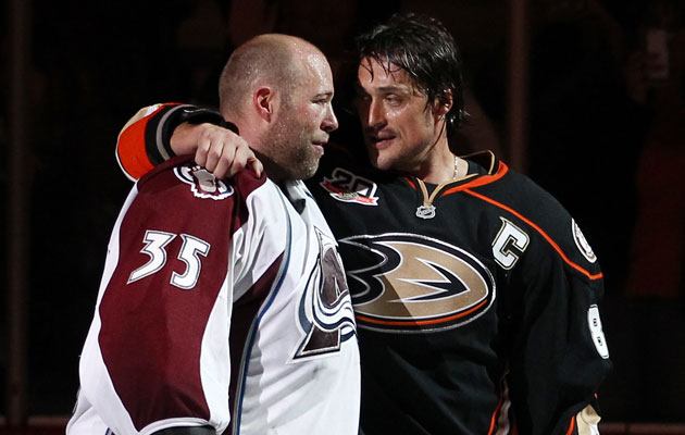 Jean-Sebastien Giguere took a bow with Teemu Selanne in Anaheim. (Getty Images)