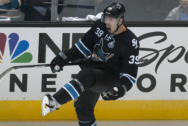 Logan Couture is obviously happy with his new deal in San Jose. (USATSI)