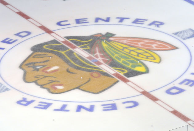 The Blackhawks logo at center ice in Chicago. (USATSI)