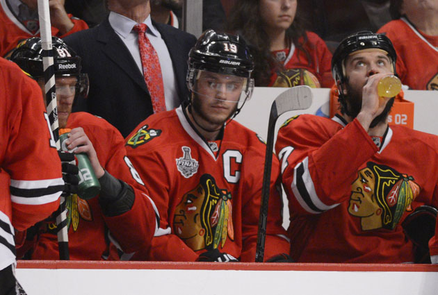 Jonathan Toews watched the third period of Game 5 from the bench. (USATSI)