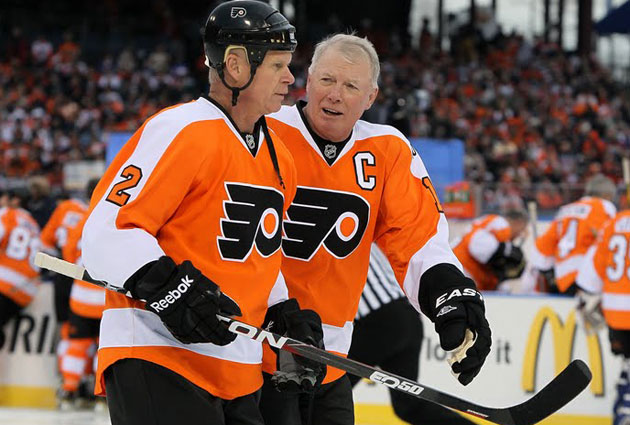 Mark Howe and Bobby Clarke play in the 2012 Winter Classic Alumni Game. (Getty Images)