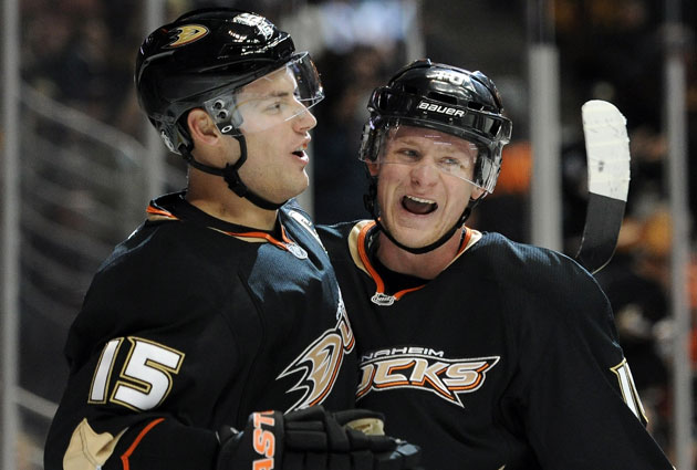 The Anaheim Ducks signed Ryan Getzlaf (left) to an eight-year contract. Can they also get Corey Perry? (Getty Images)