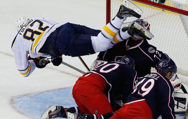 Foligno goes airborne to score a goal on Tuesday night. (USATSI)