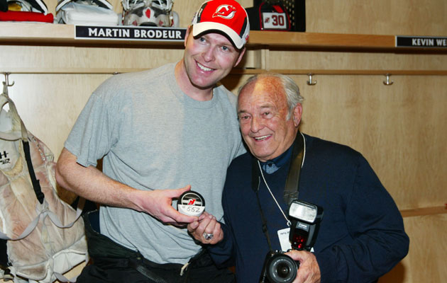 Martin Brodeur and father Denis pose for a picture with tools of their trades. (Getty Images)