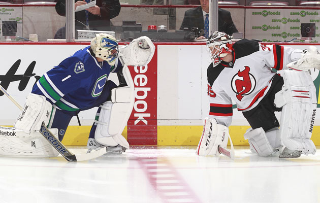 Luongo and Schneider chatting about the weather and family. (Getty Images)