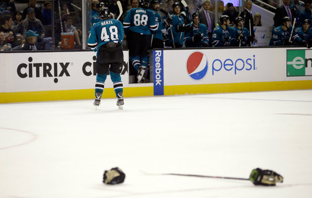 Hertl left the ice with his gloves and stick behind. (Getty Images)