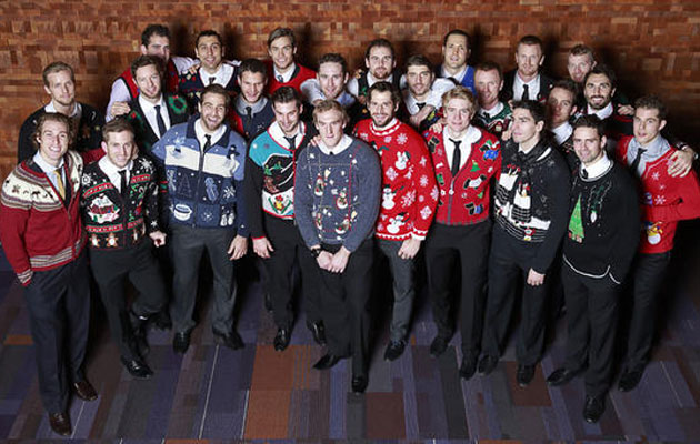 The Canucks show off their choice of sweaters. (Canucks)
