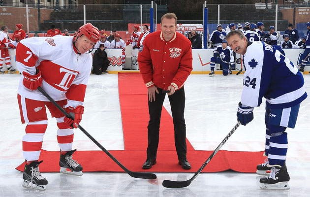 Berenson takes the ceremonial faceoff from Nick Lidstrom. (Getty Images)