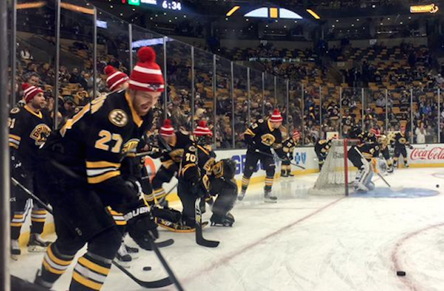 39f92177b LOOK  Bruins ready for Super Bowl in Patriots hats in warmups ...