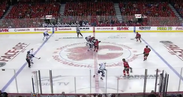 The Vancouver Canucks and Calgary Flames dropped the gloves right off the opening face-off. (HockeyFights/YouTube)