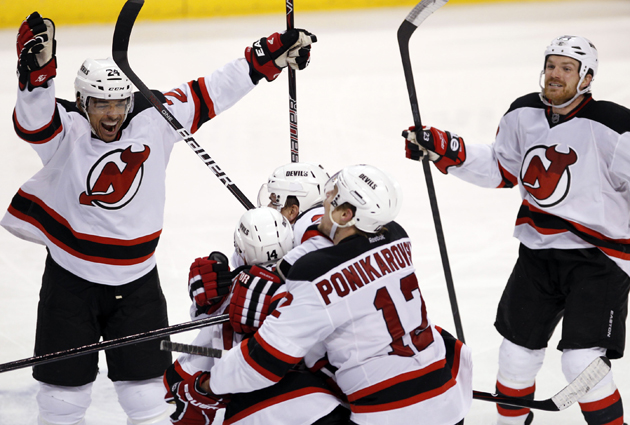 be84fc4dc33 The New Jersey Devils celebrate winning game 7 to eliminate the Florida  Panthers on Thursday in Sunrise