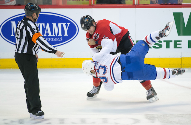 Zach Smith fights Francis Bouilon during the third period of Sunday's game. (USATSI)