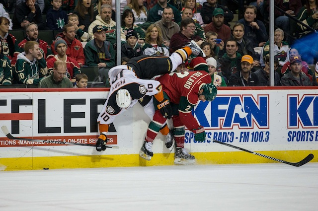 Wild D Keith Ballard had to fight because of this hit on Anaheim's Corey Perry. (USATSI)