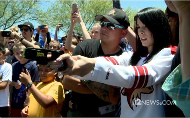This Coyotes fan got to legally taser the mayor of Glendale. (12News)