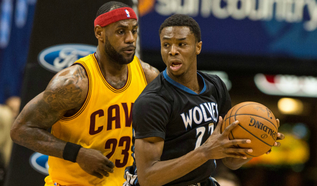 Andrew Wiggins makes a move against LeBron James.  (USATSI)