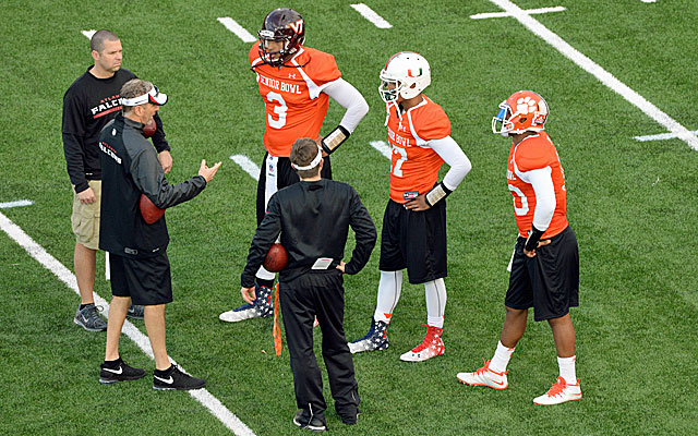 Coaches work with North quarterbacks Logan Thomas, Stephen Morris and Tajh Boyd during practice. (USATSI)