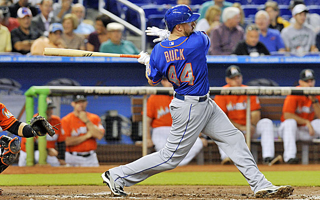 Mets catcher John Buck connects for a base hit in the second inning against the Marlins on Wednesday. (USATSI)