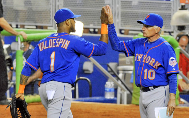 Terry Collins (right) high-fives Jordany Valdespin after the Mets beat the Marlins 7-6 Wednesday. (USATSI)