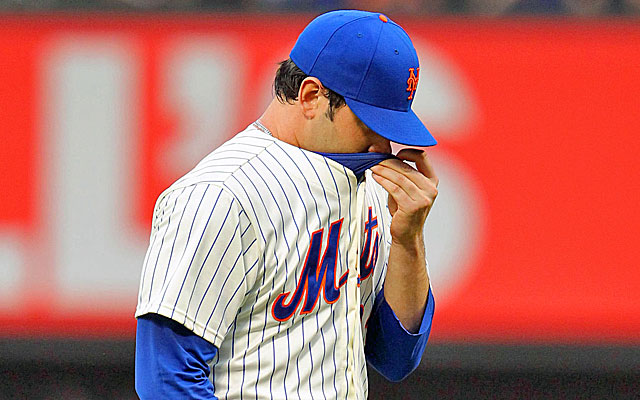 Matt Harvey stops to wipe his bloody nose while pitching against the White Sox on Tuesday. (USATSI)