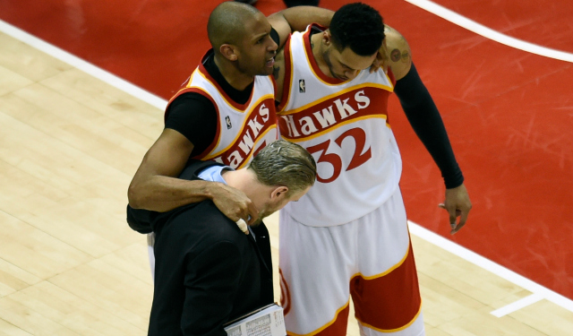 Al Horford is helped off the court.  (USATSI)