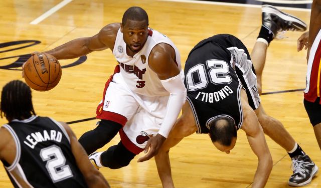 Dwyane Wade and Manu Ginobili face off in the NBA Finals.  (USATSI)
