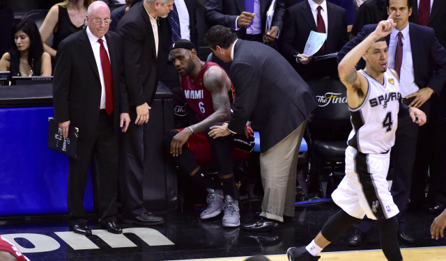 LeBron James on the sideline, where he spent most of the fourth quarter in Game 1.