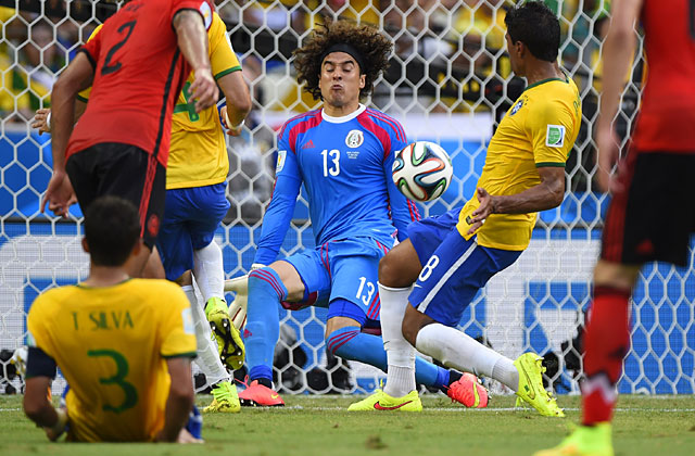 Guillermo Ochoa had four highlight-reel saves, including a diving stop on Neymar's header. (Getty Images)
