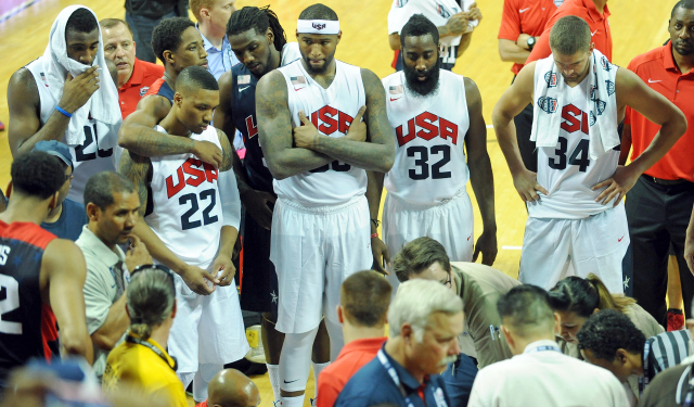 Team USA players surround Paul George after his injury.