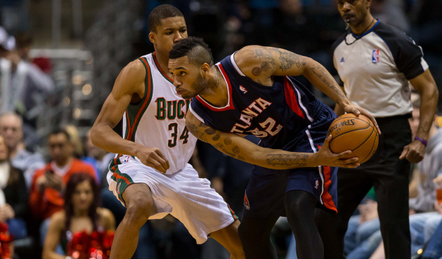 Mike Scott and his emoji tattoos are coming back to Atlanta.