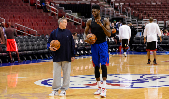 Pregame, Nerlens Noel works with Philadelphia head coach Brett Brown.  (USATSI)